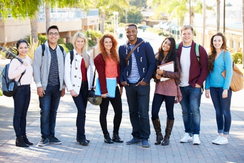 Portrait Of University Students Outdoors On Campus